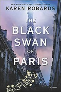 The Eiffel Tower stands black and foreboding between two equally-dark building fronts. Behind it, the sky is lavender and pink. In front of the image is the title, in white, The Black Swan of Paris. Also in front of the image are gold leaves and roses, which end with the outline of a swan.